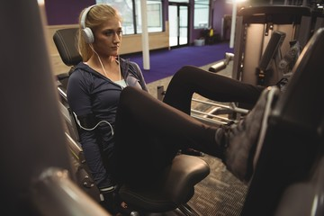 Fit woman exercising on a machine