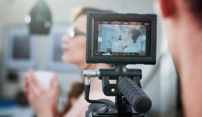 Shot of cameraman making a footage