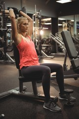 Fit woman exercising with a dumbbell
