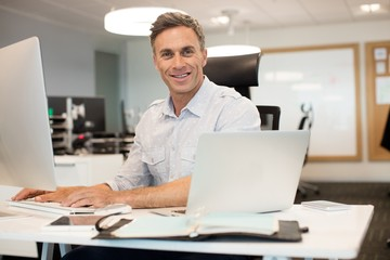 Portrait of businessman working on computer in office