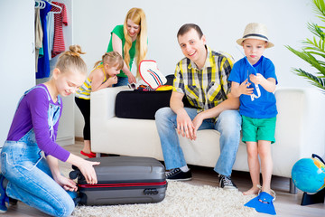 Family packing suitcases