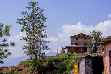 beautiful background of old house on the high mountain with blue sky and clouds on background