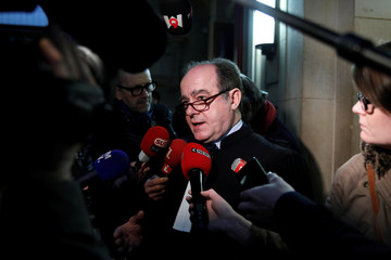 "Georges Holleaux, a lawyer representing the two widows of the men killed and 16 other people affected, talks to journalists before the opening of the trial of Ilich Ramirez Sanchez, known as ""Carlos the Jackal"", at the courthouse in Paris"