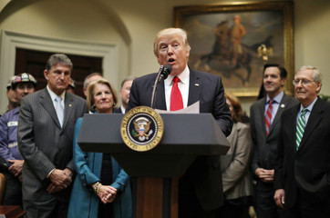 U.S. President Donald Trump speaks  during the signing of H.J. Resolution 38, at the White House in Washington