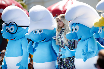 """Actor and singer Meghan Trainor poses with smurf characters at the premiere of the film """"Smurfs: The Lost Village"""" in Culver City, California"""