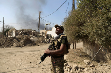 An Iraqi rapid response member stands guard near the field hospital, as Iraqi forces battle with Islamic State militants, western Mosul