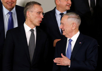 NATO Secretary-General Stoltenberg and U.S. Defense Secretary Mattis pose for a family photo during a NATO defence ministers meeting in Brussels