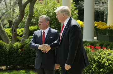 U.S. President Trump greets Jordan's King Abdullah II after joint news conference at the White House in Washington
