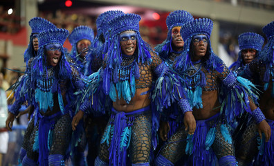 Revellers from Beija-Flor samba school perform during the carnival parade at the Sambadrome in Rio de Janeiro