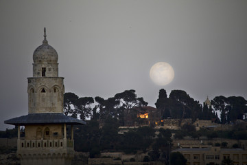 Moon rises over Jerusalem