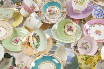 Collection of antique teacups and saucers.
