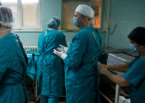 Meho Kovacevic, a 43-year-old orthopedic surgeon, participates in a surgical operation in Zenica, Bosnia and Herzegovina