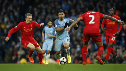 Manchester City's Sergio Aguero in action with Liverpool's Lucas Leiva