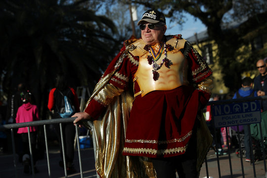 A man waits for the Bacchus parade to begin during Mardi Gras in New Orleans, Louisiana