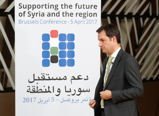 Belgium's Cooperation Minister De Croo arrives for a group photo during an international conference on the future of Syria and the region in Brussels