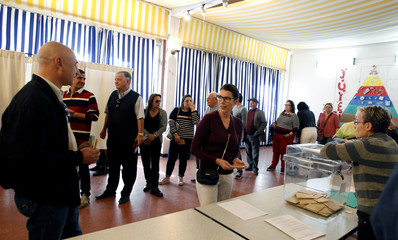 French citizens, who reside in Tunisia, line up to cast their votes for French presidential election, at a polling station in Tunis