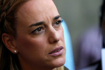 Lilian Tintori, wife of jailed opposition leader Leopoldo Lopez, talks to the media during a gathering outside of the offices of Venezuela's ombudsman in Caracas