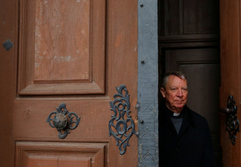 Miklos Beer, the bishop of Vac, stands at the gates of the cathedral in Vac