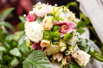 elegant wedding bouquet on table at restaurant