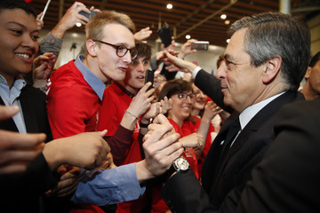 Francois Fillon, former French Prime Minister, member of the Republicans political party and 2017 French presidential election candidate of the French centre-right, is greeted by supporters as he arrives to attend a campaign rally in Lille