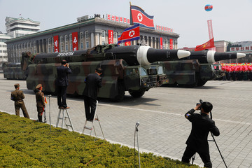 Missiles are driven past the stand during a military parade marking the 105th birth anniversary of country's founding father in Pyongyang