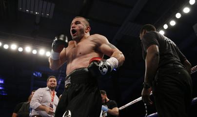 Avtandil Khurtsidze celebrates after winning the fight