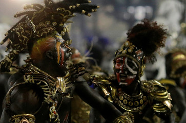Revellers from Vila Isabel samba school perform during the carnival parade at the Sambadrome in Rio de Janeiro