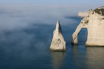 "The ""Porte d'Aval"", a famous arch of the Etretat's cliffs, is seen amidst sea mist in western France"