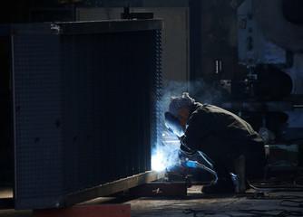 A man works at a factory at the Keihin industrial zone in Kawasaki