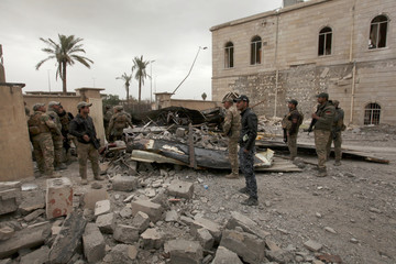Iraqi rapid response forces are seen during clashes with Islamic State militants in Mosul