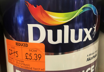 Cans of Dulux paint, an Akzo Nobel brand, are seen on the shelves of a hardware store near Manchester, Britain.