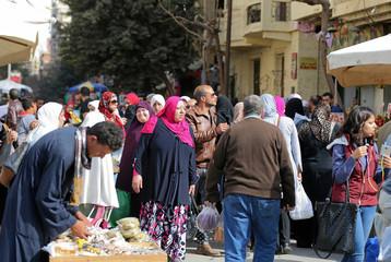 Pedestrians walk along a street in downtown Cairo