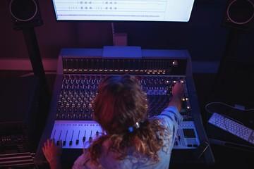 Male audio engineer using sound mixer