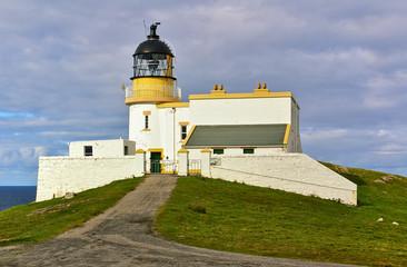 Lighthouse on a grassy hill