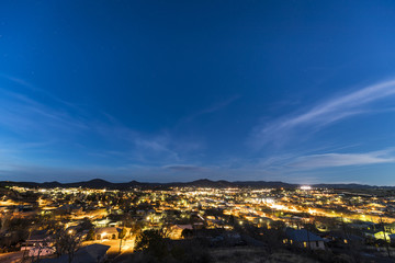 Small mountain town under the stars at night
