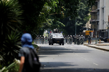 A demonstrator rallies against Venezuela's President Nicolas Maduro in Caracas