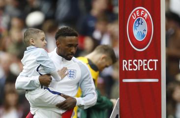 England's Jermain Defoe with mascot Bradley Lowery before the match