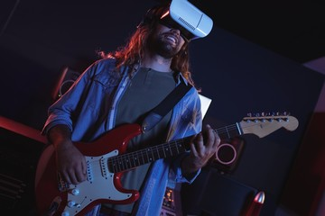 Male audio engineer using virtual reality headset