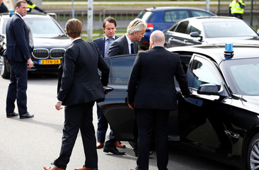 Dutch far right Party for Freedom (PVV) leader Geert Wilders leaves after speaksing to the press during his campaign for the 2017 Dutch election in Amsterdam