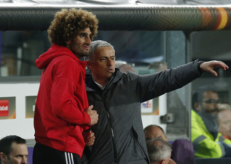 Manchester United manager Jose Mourinho and Marouane Fellaini