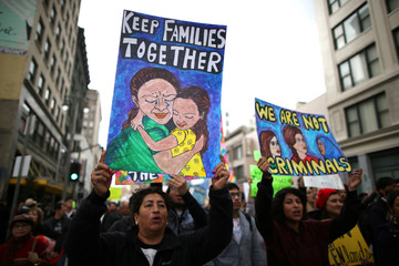 People participate in a protest march calling for human rights and dignity for immigrants, in Los Angeles