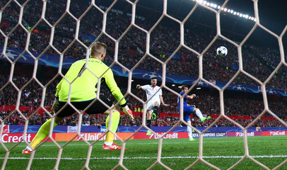Sevilla's Pablo Sarabia scores their first goal