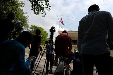 Members of the media gather in front of the North Korea embassy in Kuala Lumpur