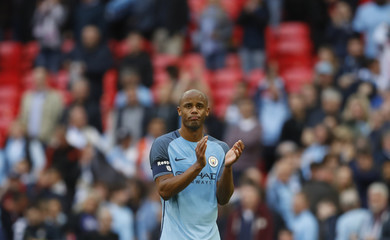 Manchester City's Vincent Kompany looks dejected after the match