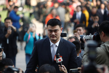 Yao Ming, a delegate and a former NBA player arrives near the Great Hall of the People before the opening session of the Chinese People's Political Consultative Conference (CPPCC) in Beijing