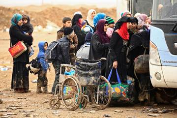Displaced Iraqi people who fled their homes during a battle between Iraqi forces and Islamic State militants, transfer to Hammam al-Alil camp, in Mosul
