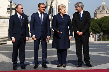 "Malta's PM Muscat, European Council President Tusk, Lithuania's President Grybauskaite and Italy's PM Gentiloni pose for a picture outside the city hall ""Campidoglio"" on the 60th anniversary of the Treaty of Rome, in Rome"