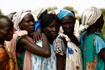 Women wait in line during a UNICEF supported mobile health clinic in the village of Rubkuai, Unity State, South Sudan
