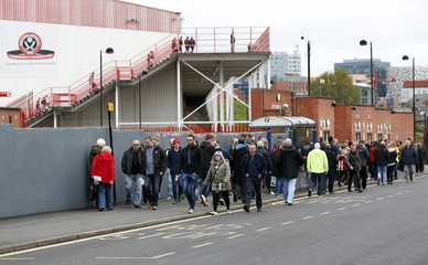 Fans make their way to the stadium ahead of the match