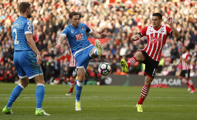 Southampton's Dusan Tadic in action with Bournemouth's Dan Gosling